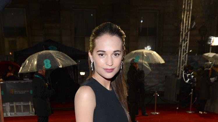 Alicia Vikander arrives for the BAFTA Film Awards at the Royal Opera House on Sunday, Feb. 10, 2013, in London. (Photo by Jon Furniss/Invision/AP)
