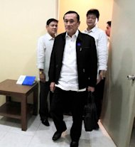Senate security officers escort Cesar Ramirez to the Senate detention room after being cited for contempt by Agriculture and Food Chairman Senator Francis Pangilinan. (Senate PRIB photo by Joseph Vidal)
