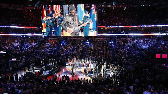 The National anthem is played during the NBA All Star basketball game, Sunday, Feb. 16, 2014, in New Orleans