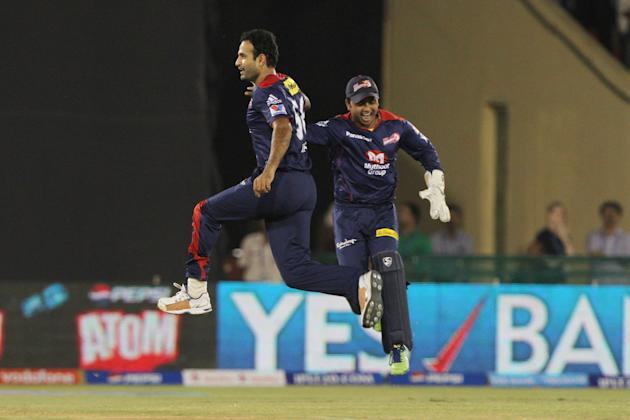 Delhi Daredevils player Irfan Pathan ,Kedar Jadhav celebrates the wicket of Kolkatta Knight Riders captain Gautam Gambhir during match 44 of the Pepsi Indian Premier League between The Delhi Daredevil