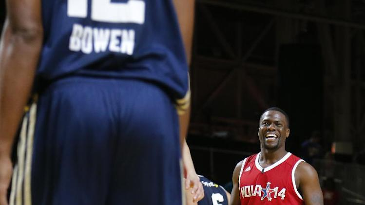 West's Kevin Hart (1)  talks with East's Bruce Bowen during a break in the second half of the NBA All-Star celebrity basketball game in New Orleans, Friday, Feb. 14, 2014.  The East won 60-56
