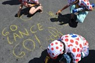 Young fans of US cyclist Lance Armstrong write messages on the ground in Marseille before the third stage of the 2009 Tour de France. Disgraced cycling icon Armstrong might be prepared to take a lie detector test, his lawyer has suggested, as further damning evidence emerges of the intimidation and threats he used to cover up his alleged drug taking