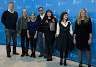 The jury of the 63rd Berlinale film festival (from L) US actor/director Tim Robbins, German director and screenwriter Andreas Dresen, Iranian director Shirin Neshat, Chinese director Wong Kar-Wai, Danish director Susanne Bier, Greek director Athina Rachel Tsangari and US cinematographer Ellen Kuras pose for photographers during a photocall in Berlin, February 7, 2013