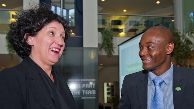 """Belgium's Interior Minister Annemie Turtelboom, left smiles as she talks with Belgian soccer referee Jerome Efong N'zolo during the launch of the """"Respect United"""" campaign at the Royal Belgian Football Association in Brussels, Monday Sept. 26, 2011. On Monday, the Belgian government and football authorities launched Respect United club, the latest initiative to stamp out racism in European football. All realize though, a goodwill initiative in itself will not do the trick.(AP Photo/Geert Vanden Wijngaert)"""