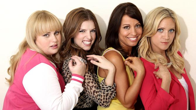 "In this image taken on Fri., Sept. 21, 2012, from left, actress Rebel Wilson, actress Anna Kendrick, screenwriter Kay Cannon, and actress Brittany Snow, from the film ""Pitch Perfect,"" pose for a portrait at The London Hotel, in West Hollywood, Calif. The musical comedy, which counts Elizabeth Banks among its producers, focuses on the competitive world of college a cappella. Full of music and laughs, the story centers on the Bellas, an all-female group of singing misfits. (Photo by Matt Sayles/Invision/AP)"
