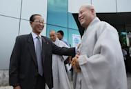 Sim Sang Jin from North Korea's Buddhist Association, left, greets Ri Kyong-sik of South Korea's Jogye Buddhist sect at Pyongyang airport in Pyongyang, North Korea, Saturday, Sept. 3, 2011. Due to political tensions, South Korean citizens are prohibited from traveling to North Korea without government permission. However, the religious delegation received approval in Seoul to make the rare trip to attend a ceremony at ancient Pohyon Temple in the mountains northwest of the North Korean capital. (AP Photos/APTN)