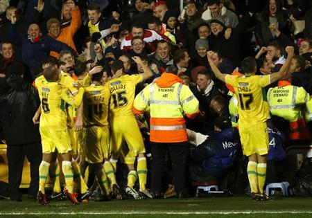 Sheffield United's Shaun Miller (obscured) celebrates with team mates after scoring the winning goal against Fulham during their English FA Cup soccer match at Craven Cottage in London February 4, 2014. REUTERS/Eddie Keogh
