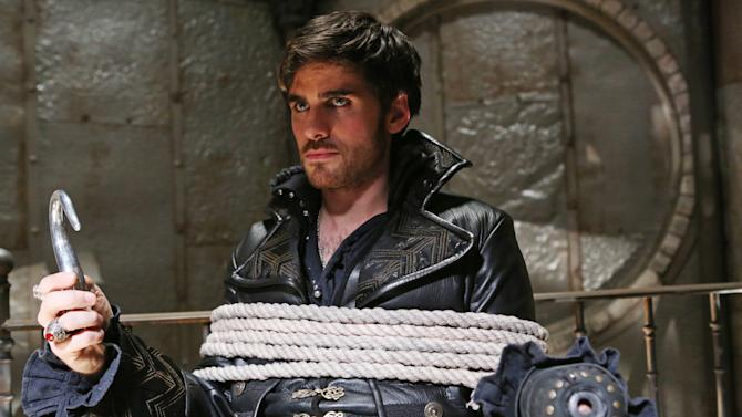 """This publicity photo released by ABC shows Colin O'Donoghue as Captain Hook in a scene from """"Once Upon a Time,"""" on the ABC Television Network. (AP Photo/ABC, Jack Rowand)"""