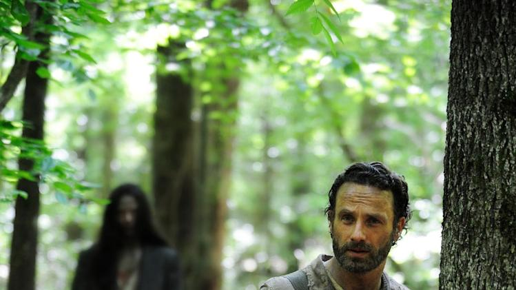 "This publicity photo released by AMC shows, Andrew Lincoln, right, as Rick Grimes, in a scene from Episode 1 of ""The Walking Dead,"" Season 4. (AP Photo/AMC, Gene Page)"