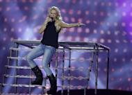 """Cascada of Germany performs her song """"Glorious"""" during a rehearsal for the final of the Eurovision Song Contest at the Malmo Arena in Malmo, Sweden, Friday, May 17, 2013. The contest is run by European television broadcasters with the event being held in Sweden as they won the competition in 2012, the final will be held in Malmo on May 18. (AP Photo/Alastair Grant)"""
