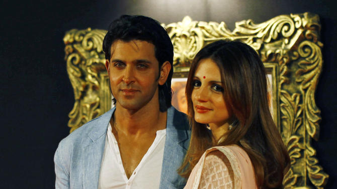 "In this Monday, Nov. 12, 2012 photo, Bollywood star Hrithik Roshan arrives with his wife Suzanne Roshan to attend the premiere of the film ""Jab Tak Hai Jaan"" or ""As Long As I Am Alive"" in Mumbai, India. Bollywood stars turned out in strength at the premiere of the movie for a final homage to movie mogul Yash Chopra, who died last month days after finishing the film. Chopra was known as the ""King of Romance"" for creating classic love stories that were immensely popular. (AP Photo/Rafiq Maqbool)"