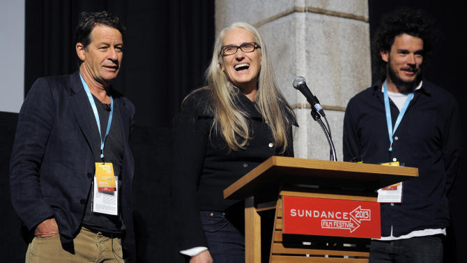 "Jane Campion, center, co-writer and co-director of the Sundance Channel scripted series ""Top of the Lake,"" addresses the audience alongside co-writer Gerard Lee, left, and co-director Garth Davis at the premiere of the series at the 2013 Sundance Film Festival, Sunday, Jan. 20, 2013, in Park City, Utah. (Photo by Chris Pizzello/Invision/AP)"