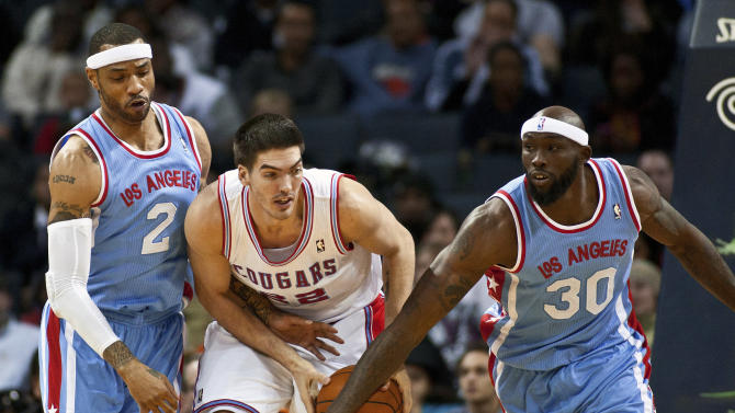 Bobcats center Mullens works to control the ball against Clippers power forward Evans and power forward Martin during their NBA basketball game in Charlotte