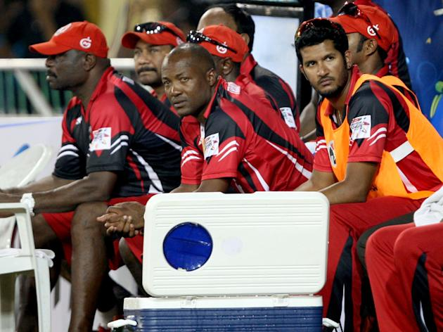 Brain Lara team manager of Trinidad & Tobago with players during the CLT20 match between Titans and Trinidad & Tobago at Sardar Patel Stadium, Motera in Ahmedabad on Sept. 30, 2013. (Photo: IANS)