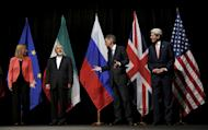 "British Foreign Secretary Philip Hammond (2nd R), U.S. Secretary of State John Kerry (R) and European Union High Representative for Foreign Affairs and Security Policy Federica Mogherini (L) talk to Iranian Foreign Minister Mohammad Javad Zarif as the wait for Russian Foreign Minister Sergey Lavrov (not pictured) for a group picture at the Vienna International Center in Vienna, Austria July 14, 2015. Iran and six major world powers reached a nuclear deal on Tuesday, capping more than a decade of on-off negotiations with an agreement that could potentially transform the Middle East, and which Israel called an ""historic surrender"". REUTERS/Carlos Barria"