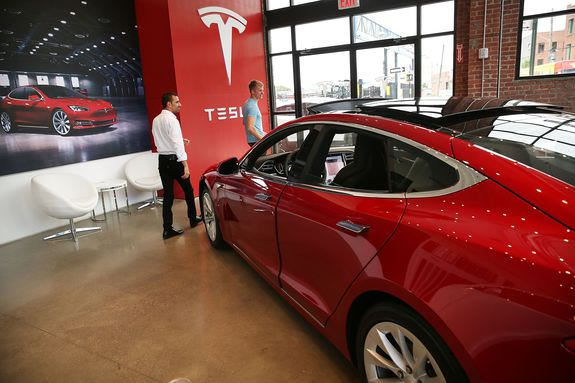 A Tesla model S sits parked in a new Tesla showroom and service center in Brooklyn, New York, July 5, 2016.
