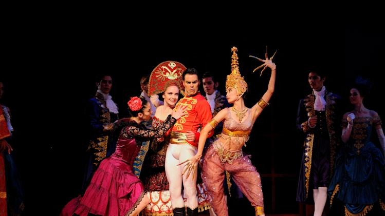 "This 2013 photo provided by the San Francisco Ballet shows, from left, Dores Andre, Sasha De Sola, Joan Boada and Wan Ting Zhao, in Wheeldon's ""Cinderella."" The production arrives at New York's David H. Koch Theater at Lincoln Center on Oct. 23. (AP Photo/San Francisco Ballet, Erik Tomasson)"