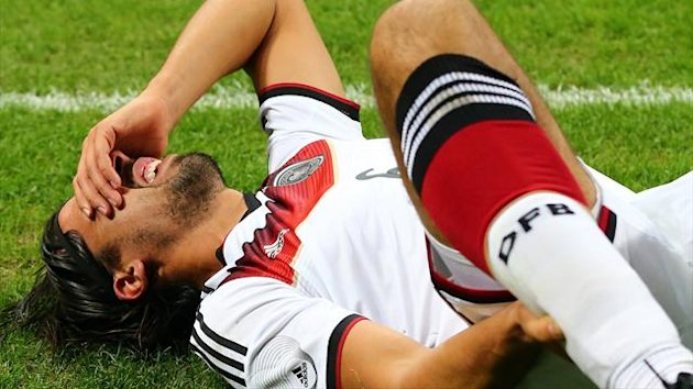 Sami Khedira lies injured during Germany's 1-1 draw in Italy (Getty)