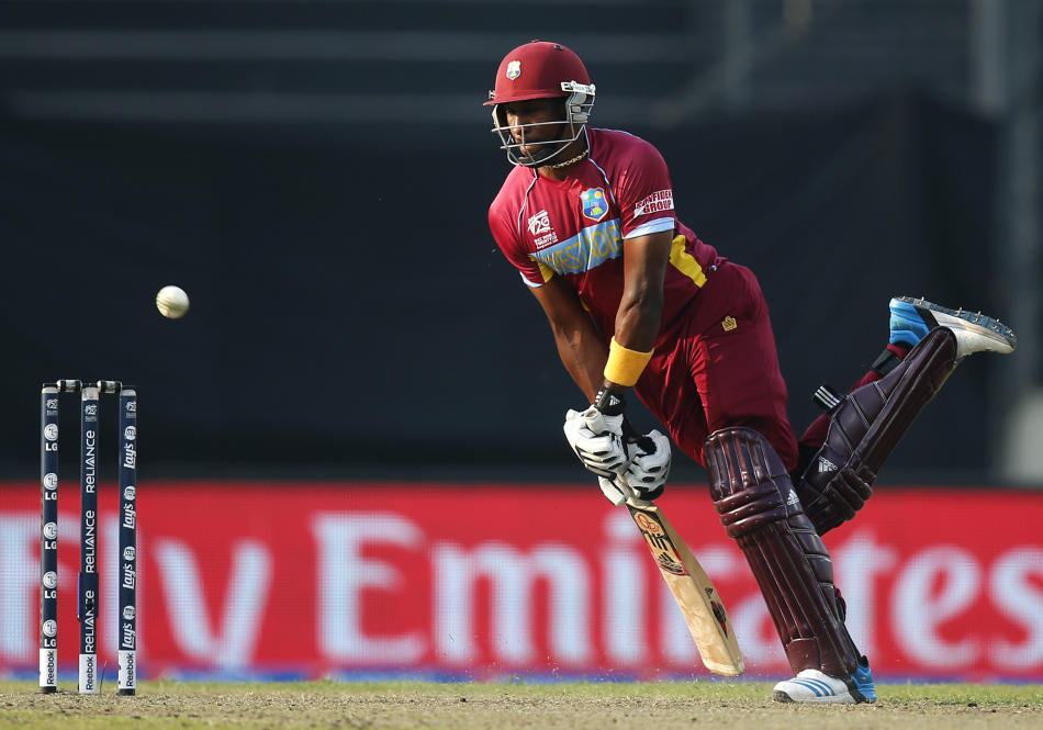 West Indies' batsman Dwayne Bravo plays a shot during their ICC Twenty20 Cricket World Cup warm up match against Sri Lanka in Dhaka, Bangladesh, Wednesday, March 19, 2014. (AP Photo/Aijaz Rahi)