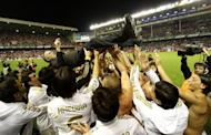 Real Madrid's players toss Real Madrid's Portuguese coach Jose Mourinho after winning the Spanish league title at the San Mames stadium in Bilbao on May 2. Jose Mourinho has declared that he has no ambition to coach in any new countries after Real Madrid's La Liga success gave him a haul of league titles from four different countries