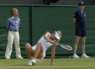 Russia's Maria Sharapova slips on the baseline during her second round women's singles match against Portugal's Michelle Larcher De Brito on day three of the 2013 Wimbledon Championships tennis tournament at the All England Club in Wimbledon, southwest London, on June 26, 2013. Sharapova crashed out of Wimbledon 6-3, 6-4 to De Brito, the world number 131