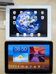 This file photo shows a Samsung Galaxy Tab 10.1, pictured under an Apple iPad, in 2011. A US appeals court gave Samsung a temporary reprieve on the sale of its Galaxy Nexus 7 smartphones while leaving intact a court ban on US sales of its tablet computers in a patent battle with Apple