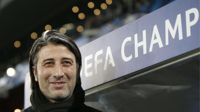 Basel's head coach Murat Yakin awaits the start of a Champions League group E group stage soccer match between Switzerland's FC Basel 1893 and Romania's FC Steaua Bucharest at the St. Jakob-Park stadium in Basel, Switzerland, Wednesday, Nov. 6, 2013