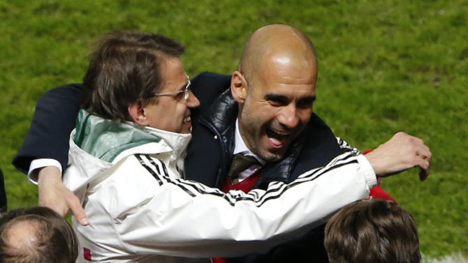 Bayern Munich's coach Guardiola celebrates winning Bundesliga title with Neuer after Bundesliga soccer match against Hertha Berlin in Berlin