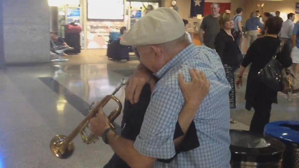 Man Surprises His Wife at Airport With Trumpet Serenade