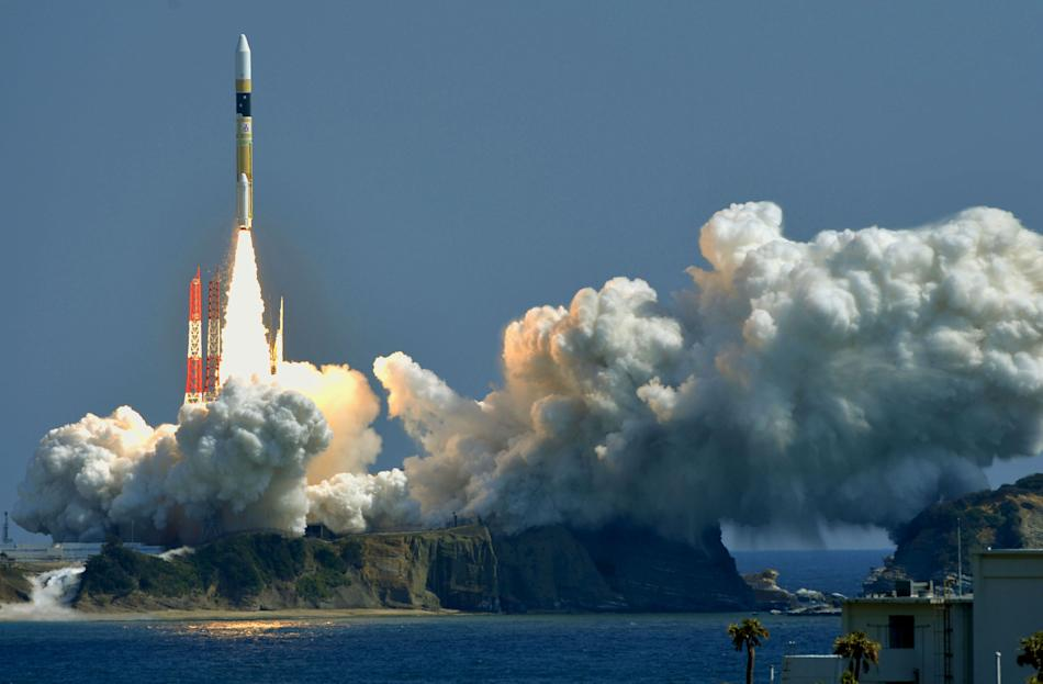 A H-IIA rocket, carrying a information gathering satellite, lifts off from the launching pad at Tanegashima Space Center on the Japanese southwestern island of Tanegashima