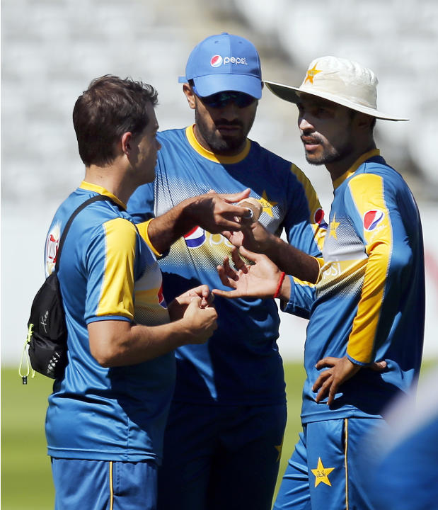 Pakistan's Mohammad Amir (R) talks with the physio during nets