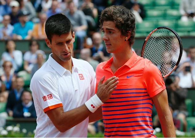 Novak Djokovic (L) cruised past 19-year-old Thanasi Kokkinakis in the third round of the French Open on May 30, 2015