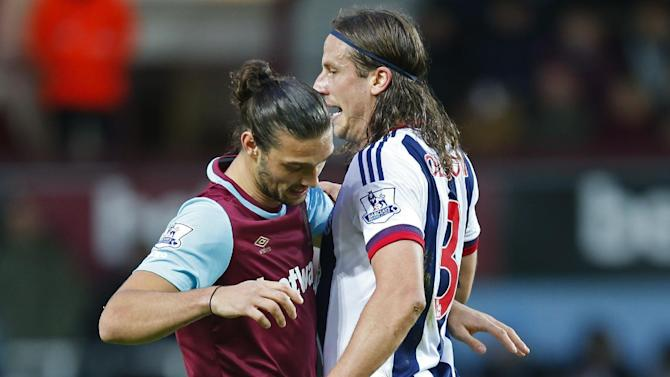 West Ham's Andy Carroll in action with West Brom's Jonas Olsson