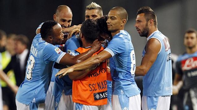 Napoli's Edinson Cavani (obscured) celebrates with his teammates after scoring against SS Lazio during their Italian Serie A soccer match at the San Paolo stadium in Naples September 26, 2012.
