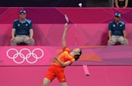 China's Li Xuerui reaches for the shuttle in the Olympic badminton women's singles final against compatriot Wang Yihan. Li won 21-15, 21-23, 21-17