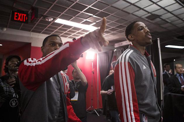 Toronto Raptors' Kyle Lowry, left,and DeMar DeRozan prepare to take to the court for the Raptors' NBA playoff game against the Brooklyn Nets in Toronto on Saturday, April 19, 2014