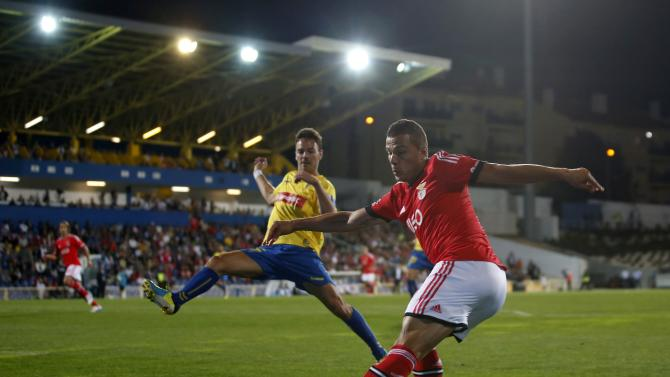 Benfica's Mauricio Lima fights for the ball with Estoril's Yohan Tavares during their Portuguese Premier League soccer match at the Coimbra da Mota stadium in Estoril
