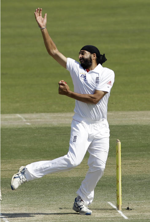 England's bowler Monty Panesar bowls a delivery during the third day of the second cricket test match of a three match series between England and Pakistan at the Zayed Cricket Stadium in Abu Dhabi, Un