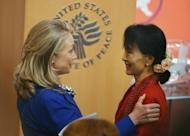 "US Secretary of State of Hillary Clinton (L) speaks to Aung San Suu Kyi after introducing her at the United States Institute of Peace. Suu Kyi, now a member of parliament, said she believes President Thein Sein is ""keen"" on change in the nation formerly known as Burma but cautioned not to look just at the executive branch as the judiciary was reform's ""weakest arm."""