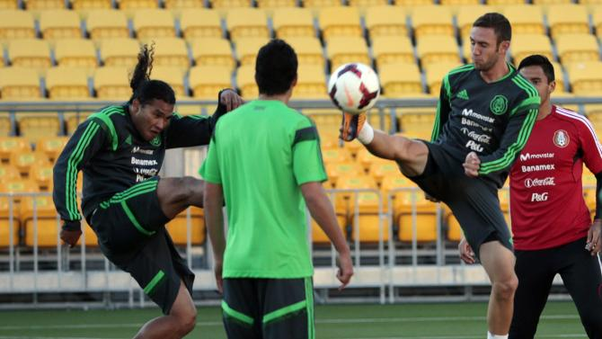 Mexico's Pena and Layun (jump for the ball during a training session for their World Cup qualifying playoff second leg soccer match against New Zealand in Wellington