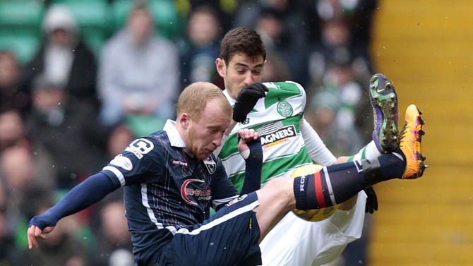 Celtic's Nir Bitton (R) in action with Ross County's Liam Boyce (L)