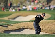 Ian Poulter plays his way out of a bunker during the quarter-finals of the WGC Match Play Championship on February 23, 2013. Poulter put away Steve Stricker 3 and 2, spoiling his American opponent's 46th birthday