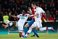 Lyon's Bakary Kone (L) vies with GFCO Ajaccio's Loic Dufau during the French Cup football match GFCO Ajaccio vs Lyon in the Francois Coty stadium in Ajaccio, Corsica. Lyon reached the French Cup final with a 4-0 win in the semi-final in Corsica