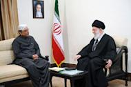 A handout picture released by the official website of Iranian Supreme Leader Ayatollah Ali Khamenei shows Khamenei (R) talking with Pakistan's President Asif Ali Zardari during a meeting on February 27, 2013 in the Iranian capital Tehran. Khamenei on Wednesday told the visiting Pakistani president that a much-delayed $7.5 billion gas pipeline project must go ahead despite US opposition