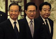 China's Premier Wen Jiabao (L), South Korea's President Lee Myung-bak (C) and Japan's Prime Minister Yoshihiko Noda arrive at a joint news conference of the fifth trilateral summit among the three nations at the Great Hall of the People in Beijing, on May 13