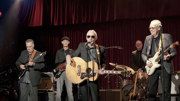 "This undated publicity film image released by Universal Pictures shows Graham Parker, center, in a scene from the Universal Pictures film, ""This is 40,""  written, co-produced and directed by Judd Apatow. (AP Photo/Universal Pictures, Suzanne Hanover)"