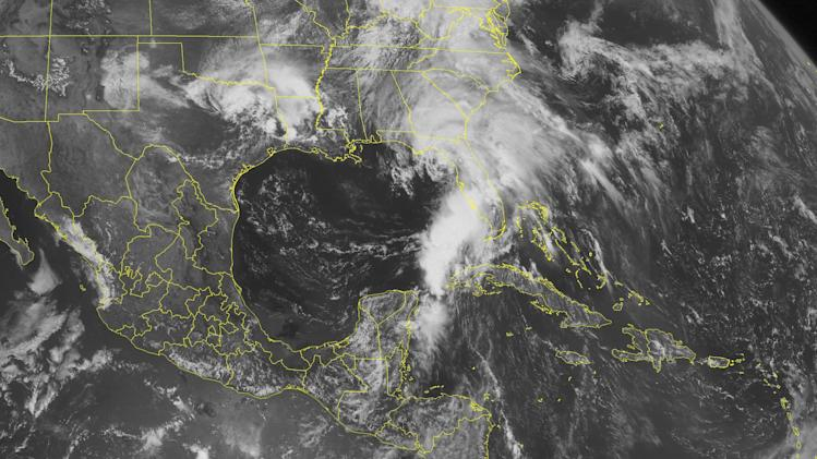 This NOAA satellite image taken Thursday, June 6, 2013 at 1:45 PM EDT shows Tropical Storm Andrea over the eastern Gulf with widespread rain and gusty winds over Florida and parts of Alabama and Georgia. Partly to mostly cloudy skies over much of the Caribbean with scattered rain showers over the Bahamas and western Cuba. (AP PHOTO/WEATHER UNDERGROUND)