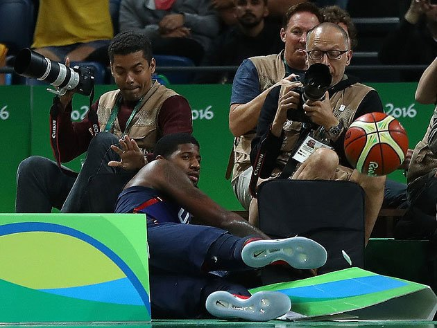 Paul George, after diving for an errant ball against Australia. (Getty Images)