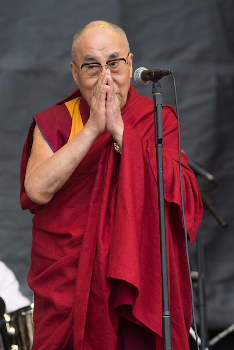The Dalai Lama onstage at the Glastonbury music festival on Sunday, June 28, 2015 at Worthy Farm, Glastonbury, England. (Photo by Jim Ross/Invision/AP)