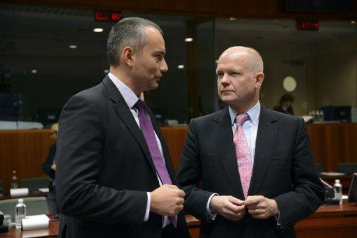 "British Foreign Minister William Hague (R) speaks with his Bulgarian counterpart Nikolay Mladenov prior to the start of a European foreign ministers meeting. European Union foreign ministers, in a new blow to President Bashar al-Assad's regime, on Monday said they viewed Syria's just-formed National Coalition to be the ""legitimate representatives"" of the Syrian people"